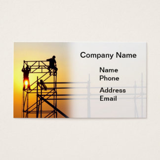 Construction Site with Workers at Sunset Business Card