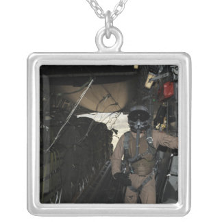 Container Delivery System bundles exit a C-17 Silver Plated Necklace