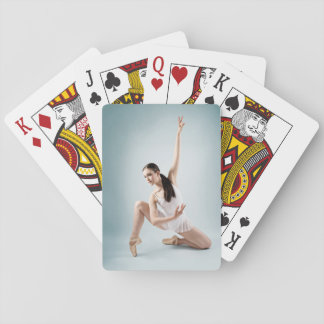 Contemporary ballet dancer playing cards