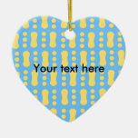Contemporary yellow peanut pattern on blue ornament