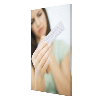 Contraceptive pills in a woman's hand. stretched canvas prints
