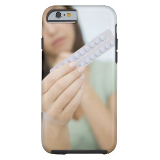 Contraceptive pills in a woman's hand. tough iPhone 6 case