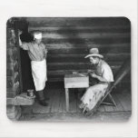 Cook watching a cowboy play cards mousepads