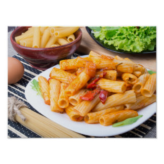 Cooked rigatoni pasta, seasoned with pepper poster