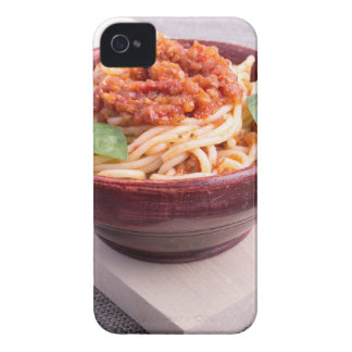 Cooked spaghetti in a brown small wooden bowl iPhone 4 Case-Mate case