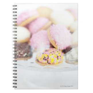 Cookies on table notebooks