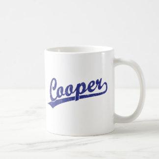 Cooper script logo in blue coffee mug