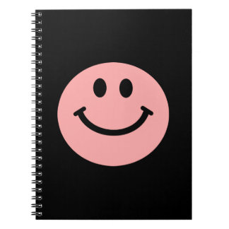 coral pink smiley face notebook