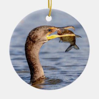 Cormorant with a fish round ceramic decoration