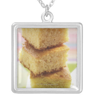 Corn bread, cut into cubes (in a pile) silver plated necklace