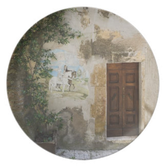 Corner of narrow lane in the old city of party plates