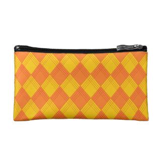 Cosmetics bag with lozenge sample in orange tones makeup bag