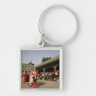 Costumed amateur folk dancers entertain key ring