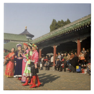 Costumed amateur folk dancers entertain large square tile