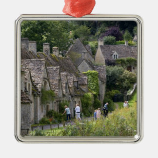 Cotswold stone cottages in the village of christmas ornament