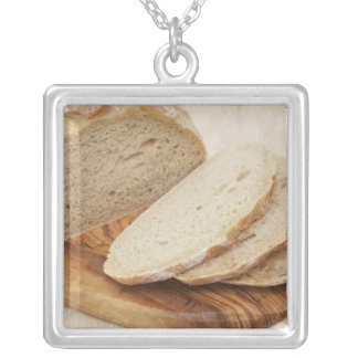 Country Bread (Pain de Campagne) on a chopping Silver Plated Necklace