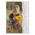 country child with sunflower bouquet