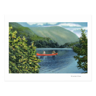 Couple Canoeing on a Lake Postcard