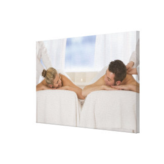 Couple getting massages stretched canvas print