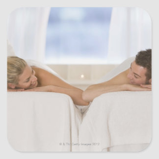 Couple getting massages square sticker