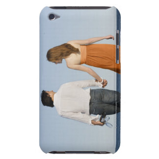 Couple holding hands and walking on beach iPod touch cases