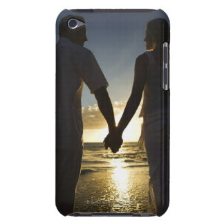Couple holding hands on beach at sunset iPod touch covers