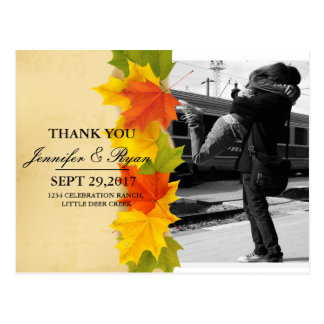 Couple hugging at the train station/fall theme postcard