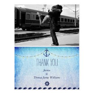 Couple hugging at the train station/nautic theme postcard