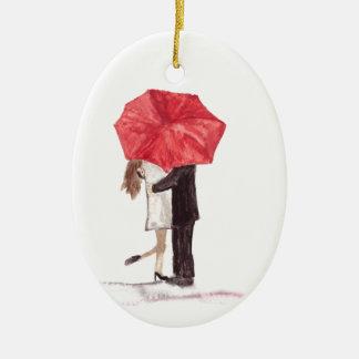 Couple in love under red umbrella ceramic oval decoration