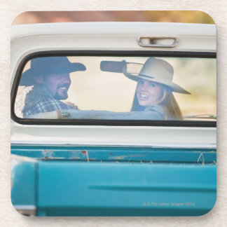 Couple in truck drink coasters