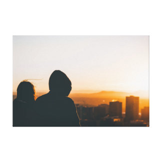 Couple looking at City Canvas Print