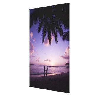 Couple on beach, Windjammer Landing, St. Lucia Canvas Prints