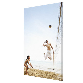 Couple Playing Beach Volleyball at Six Senses Canvas Print