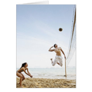 Couple Playing Beach Volleyball at Six Senses Greeting Card