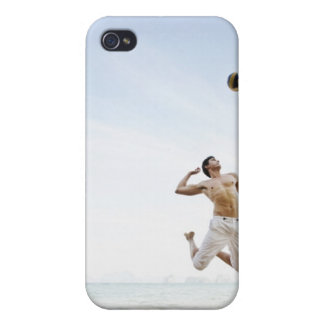Couple Playing Beach Volleyball at Six Senses iPhone 4 Covers