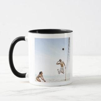 Couple Playing Beach Volleyball at Six Senses Mug