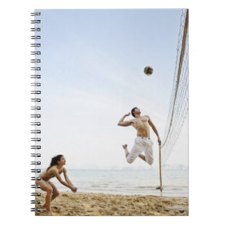 Couple Playing Beach Volleyball at Six Senses Spiral Notebook