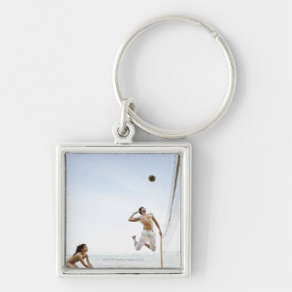 Couple Playing Beach Volleyball at Six Senses Silver-Colored Square Key Ring