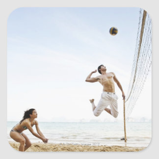 Couple Playing Beach Volleyball at Six Senses Square Sticker