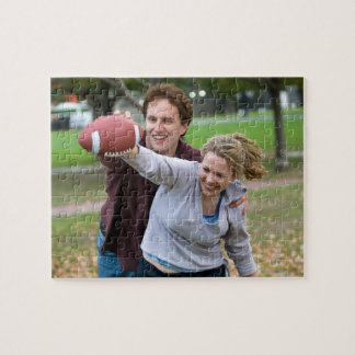 Couple playing football in park jigsaw puzzles