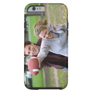 Couple playing football in park tough iPhone 6 case