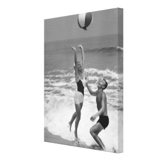 Couple Playing with a Beachball Gallery Wrap Canvas