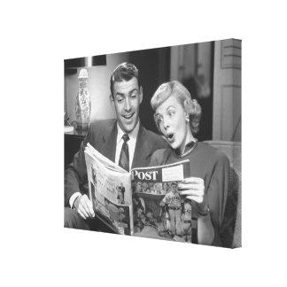 Couple Reading Magazine Canvas Print