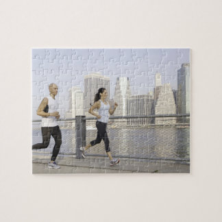 Couple running on pier with city in background jigsaw puzzle