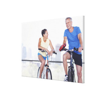 Couple sitting on bicycles canvas print