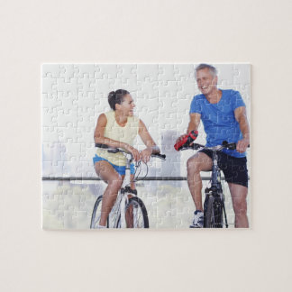 Couple sitting on bicycles puzzles
