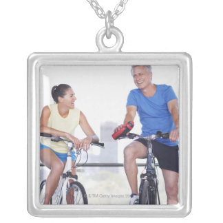 Couple sitting on bicycles square pendant necklace