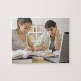 Couple studying together jigsaw puzzles