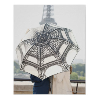 Couple under an umbrella with the Eiffel Tower Poster