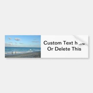 Couple walking on florida beach w seagull bumper stickers